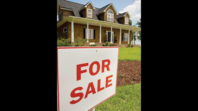 Home-and-for-sale-sign---me