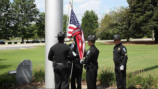 Veerapen flag raised at CPD 9-11-15 Rockdale News Martin RandIMG 4381