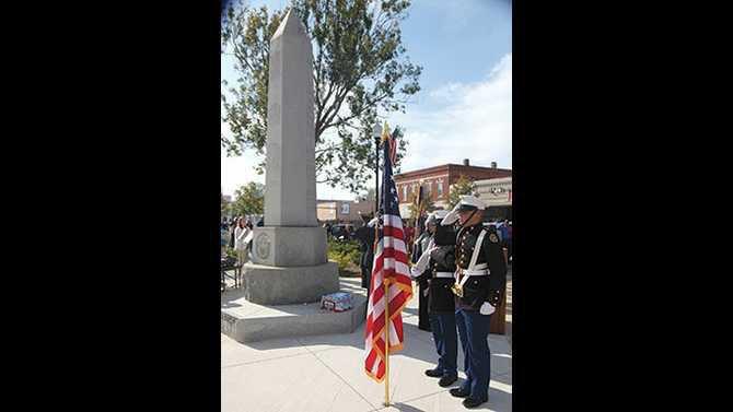 1113VETERANS-in-front-of-memorial