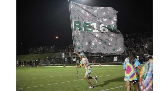 Students-raise-flag