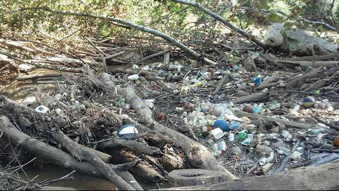 9-8-13 trash clogs Yellow-River