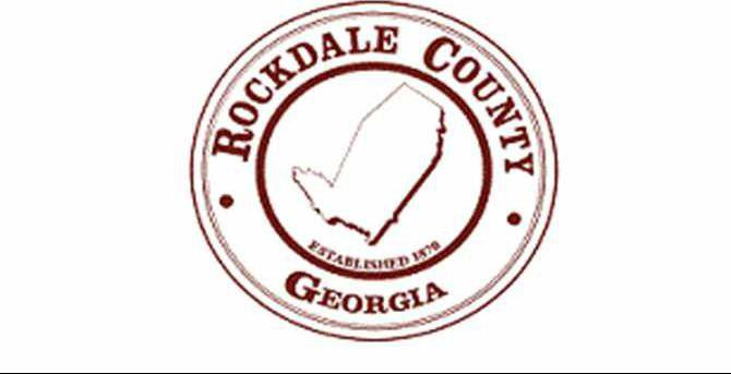 Rockdale County logo maroon pixelated