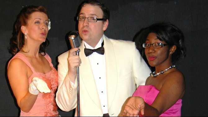 NDP brings you a Red White  Blue Christmas A Tribute to the USO Camp Shows of WWII L-R Kim Fratesi Joseph Harrison  Brittany Jackson2