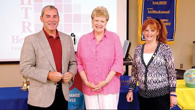 Rockdale-Rotary-Club-President-Elly-Dalton-and-treasurer-Anita-Smith-present-a-1500-donation-to-Dave-Buser-for-Rockdale-CARES
