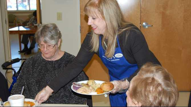 WSAs-Deedy-Pate-serves-an-early-Thanksgiving-lunch-to-some-of-over-150-senior-gathered-for-the-12th-annual-event