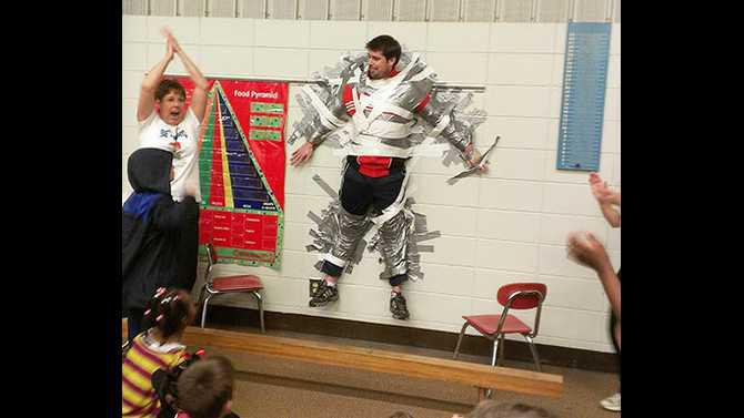 HCE-taped-Mr-Cheek-to-the-wall-fundraiser