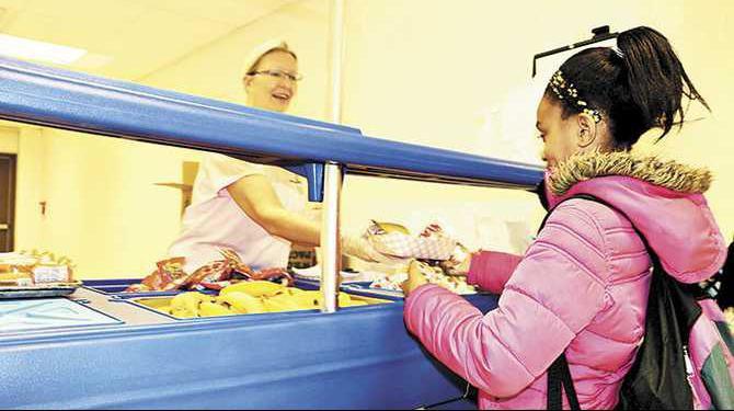 Jordyn-Kidd-gets-breakfast-from-cafeteria-worker-Cyndi-Wilson-Photo-Mar-06-6-56-45-AM