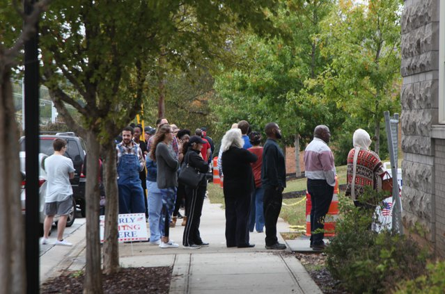 voters wait outside the county administration building to vote friday.jpg