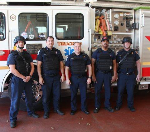 Covington firefighters try on new gear.jpg