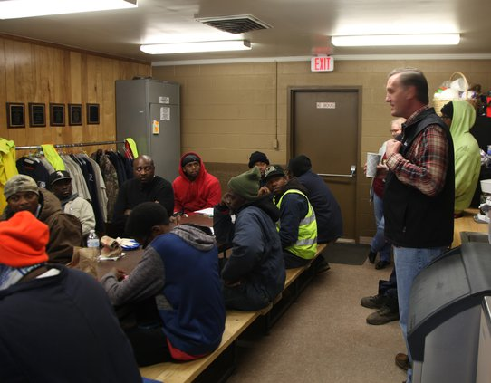 Mayor Johnston talks to sanitation workers Friday morning.jpg