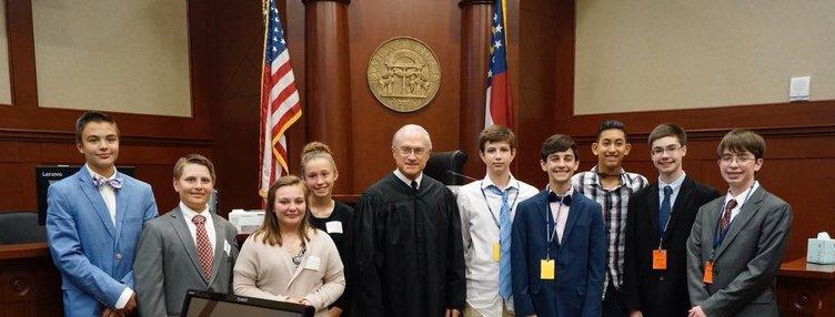 Mock Trial team pic with judge ozburn.jpg