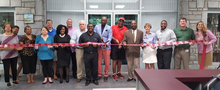 ribbon cutting smiling.jpg