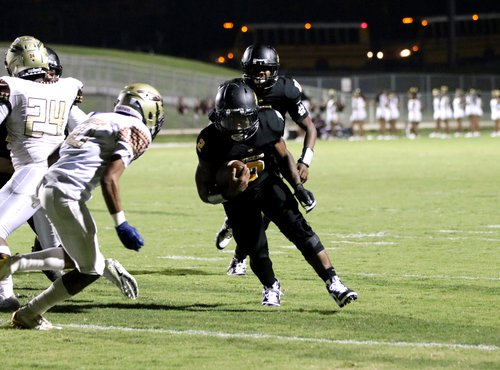 In his first game back from injury, Alcovy's Natorien Holloway (2) runs it in the end zone against the Salem defense.