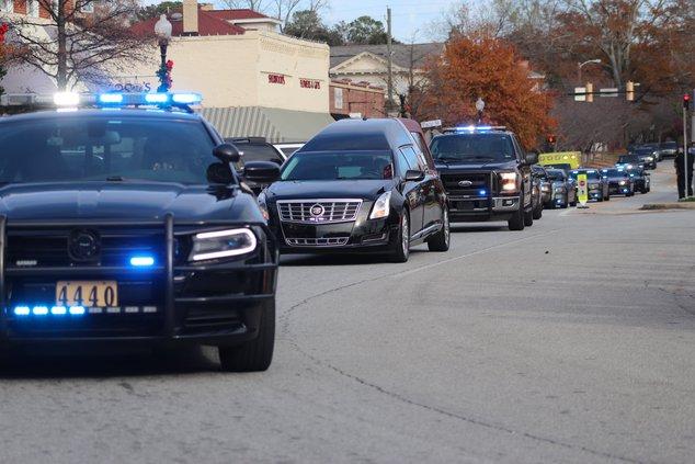 almond turner arrives home via law enforcement escort