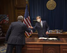 Gov. Kemp fist bumps