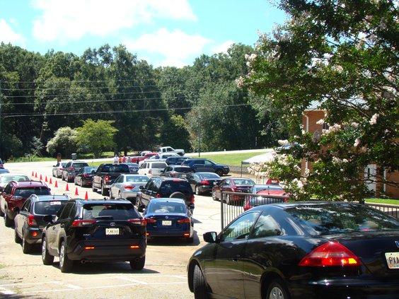 Cars flood parking lot for food giveaway