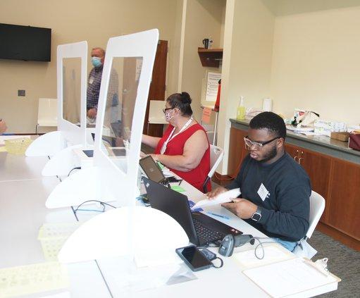 Newton County election workers Amanda Martin and Josh Porter