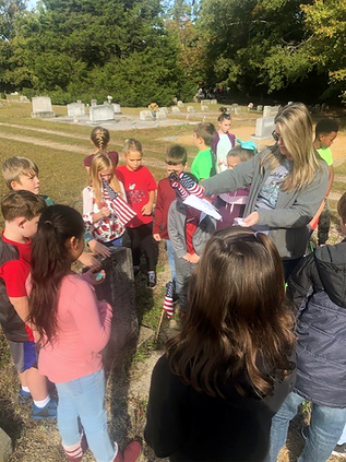 Mansfield students place flags at nearby cemetery