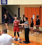 Jimmy Hughes referees basketball, football