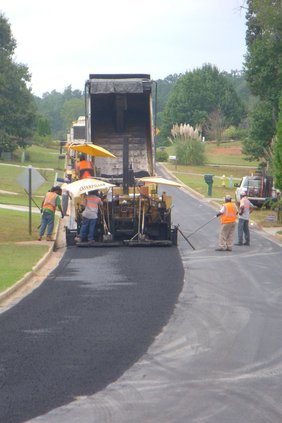Workers pave road in Newton