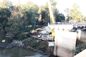 Bridge collapse excavator